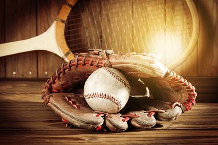 baseball glove and baseball on wood board, sport concept