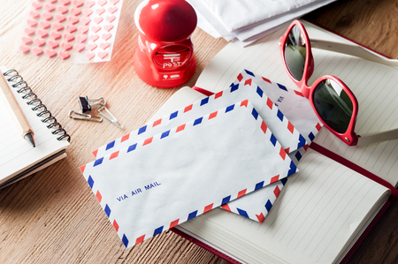 air mail envelope on the wood table Stock Photo