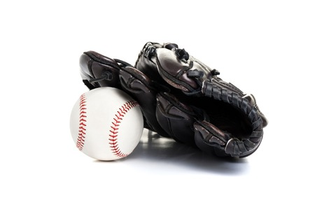 chocolate brown baseball glove with the ball isolated over white background