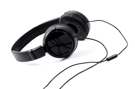 wired black headphone isolated over white background Stock Photo
