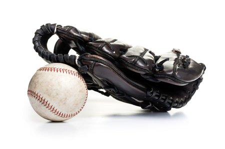 chocolate brown baseball glove with the old ball isolated over white background