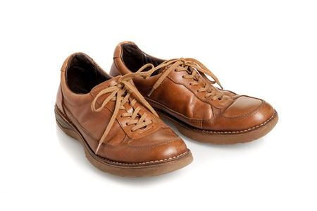 old brown leather shoes for men over white background
