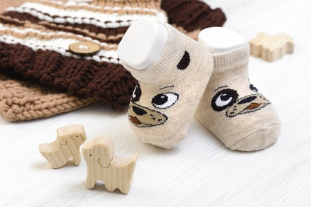 new baby socks on white wooden board, newborn and baby concept