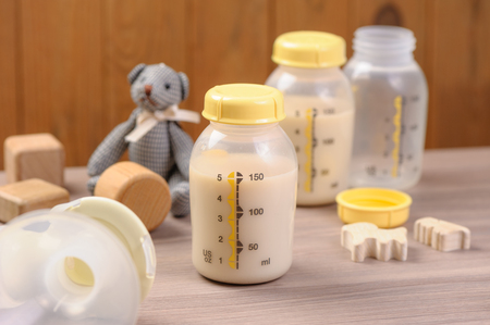 bottle of mother breast milk, breast milk storage and handling concept