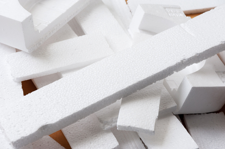Closeup white polystyrene foam on the cardboard. Polystyrene foam is cushioning material in packaging, material for craft applications and other. Фото со стока - 93319046