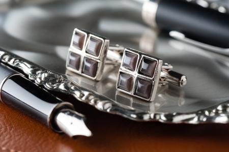 closeup shiny cufflinks with gemstones, accessory for men