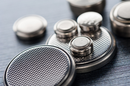 closeup button cell battery or watch battery or coin cell, used to power small electronics devices such as wrist watches or computer motherboard.