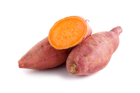 raw sweet potato isolated over white background Imagens
