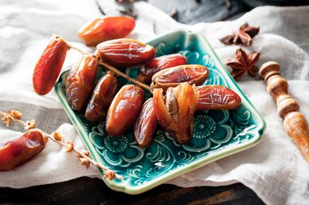closeup sweet dried date palm fruits or kurma, ramadan (ramazan) food