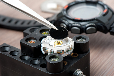 watch battery replacement, watchmaker replacing watch battery on quartz watch Stock Photo