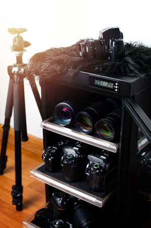 electronic dehumidify dry cabinet for storage cameras lens and other photography equipment. Closeup at status display of the cabinet. Stock Photo