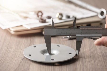 measuring the dimensions of part with metal vernier caliper, vernier caliper is a measuring instrument used to precisely measure linear dimensions. Stock Photo