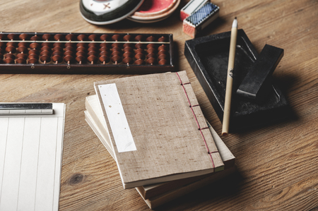 closeup vintage style of Japanese stab binding on wooden desk