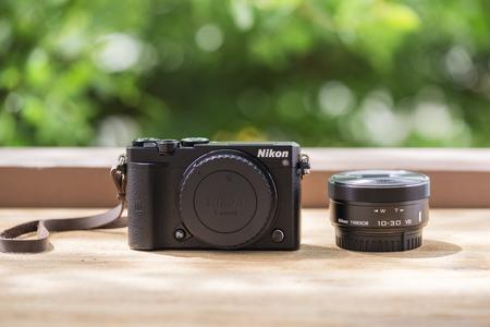 BANGKOK, THAILAND - JUNE 25, 2017: Black Nikon 1 J5 with 1 Nikkor 10-30mm. The Nikon 1 J5 is a digital mirrorless camera announced by Nikon on April 2, 2015.