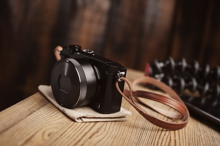 vintage style of digital mirrorless camera with leather strap Stock Photo