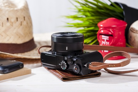 closeup vintage style of digital mirrorless camera with leather strap. Stock Photo