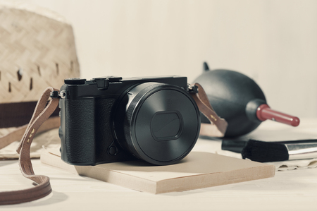 closeup vintage style of digital mirrorless camera with cleaning kits Stock Photo