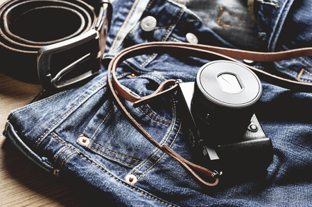 vintage style of digital mirrorless camera with leather strap with mens accessories and gadgets