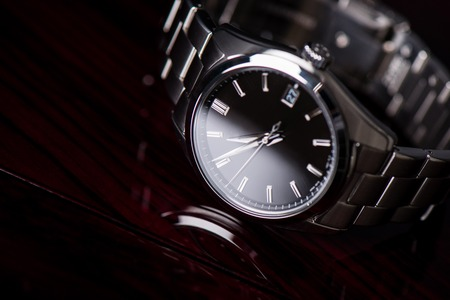 closeup luxury automatic wristwatch for men with black dial and stainless steel bracelet. Imagens