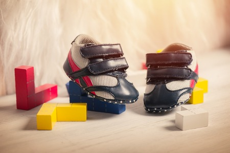 little blue shoes for baby with toys, baby clothing, baby accessories Banque d'images