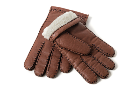 Pair of mens brown leather gloves with accent stitching in dark brown over white background. Фото со стока