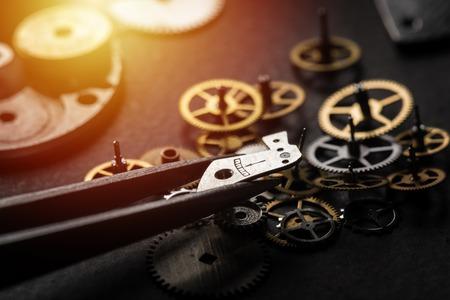 mechanical watch repairing concept. closeup the parts of mechanical wristwatch.