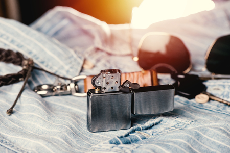 Brushed chrome lighter with windproof. One of everyday carry item for men. Stock Photo