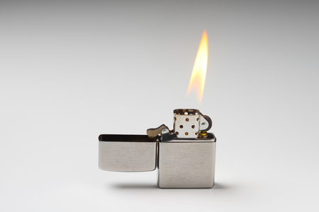 Brushed chrome lighter with windproof. One of everyday carry item for men. Foto de archivo