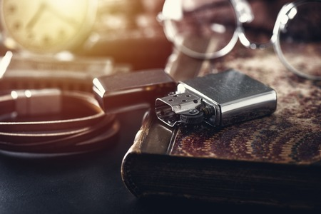 Brushed chrome lighter with windproof. One of everyday carry item for men. Shallow depth of field.