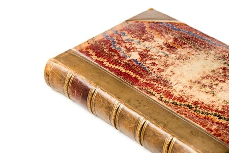 antique leather bound book with marbling paper cover isolated over white background.