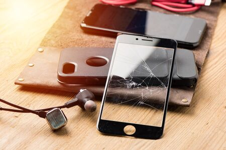 closeup broken tempered glass screen protector for smartphone.