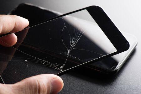 closeup broken tempered glass screen protector for smartphone. Stok Fotoğraf