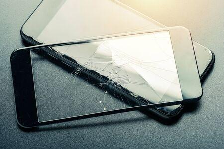 closeup broken tempered glass screen protector for smartphone. Banco de Imagens