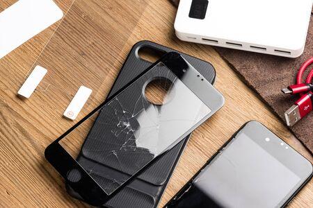 closeup broken tempered glass screen protector for smartphone.
