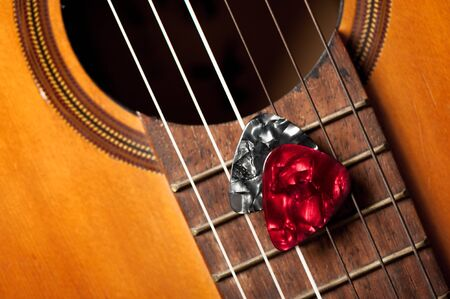 Closeup guitar pick on an old classical guitar. A guitar pick is a plectrum used for guitars. 写真素材