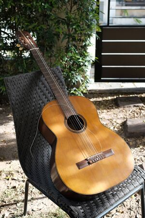 closeup broken string on vintage classical guitar.