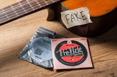 BANGKOK, THAILAND - JULY 03, 2018: Counterfeit DAddario Pro-Arte classical guitar strings with registered serial number.