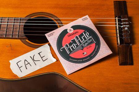 BANGKOK, THAILAND - JULY 03, 2018: Counterfeit DAddario Pro-Arte classical guitar strings.