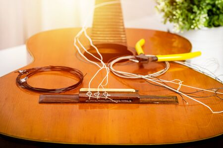 Restring classical guitar concept. Closeup at the new strings. Stock Photo