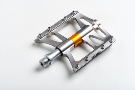 isolate lightweight aluminium bicycle pedal with titanium color. bicycle parts.