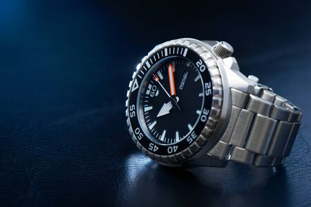 luxury men watch with black dial and stainless steel bracelet.