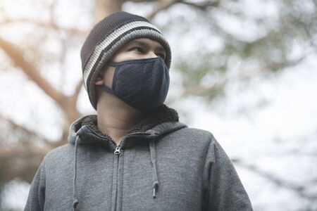 Portrait of asian man wearing cloth mask to against air pollution