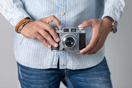 Old film camera in man's hand. Photography and hobby concept.  Stock Photo