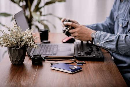 Closeup external hard drive on wooden desktop. Working with external hard drive.