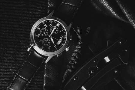 Closeup at luxury men wristwatch with black dial and leather strap. 版權商用圖片