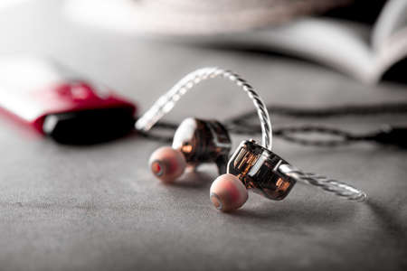 Wired earphones for smartphone and other player. Selective focus on earphone. 免版税图像