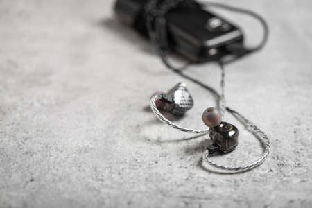 Wired earphones for smartphone and other player. Selective focus on earphone. 免版税图像 - 166680298