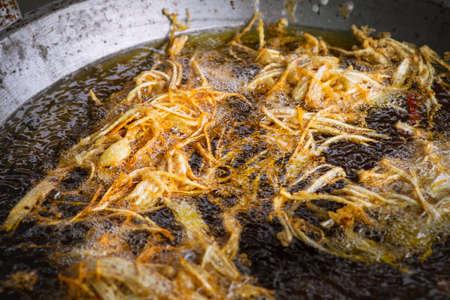 Frying shredded taro in hot oil. Cooking crispy shredded taro, vegetarian food.