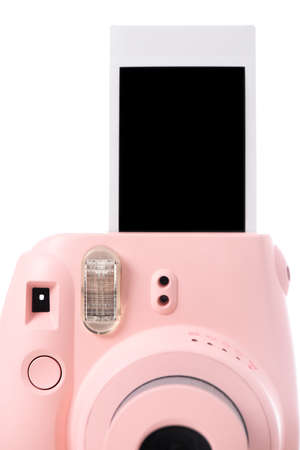 The pink instant camera with blank instant films over white background.
