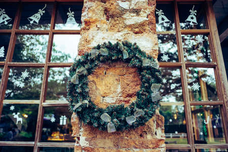 Christmas wreath and bow decoration in winter.  Christmas and New year cerebration.